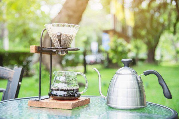 making-drip-coffee-vintage-coffee-shop-with-green-garden-nature_1150-14516.jpg